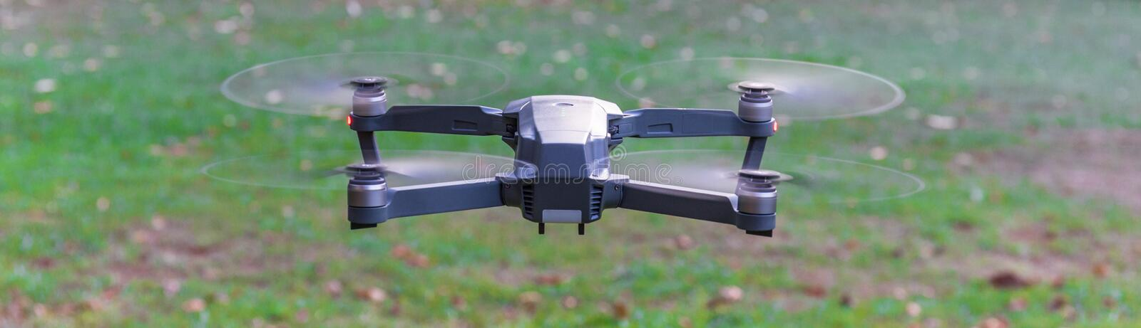 Drone on a flying above grass royalty free stock images