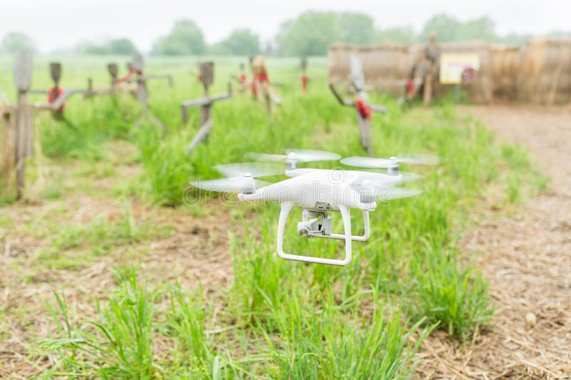 Drone flying above green crop field. Close up of drone flying above green wheat field in summer. High technology innovations royalty free stock photo