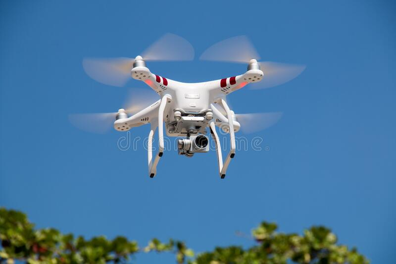 Drone Flying Against Blue Sky stock photos