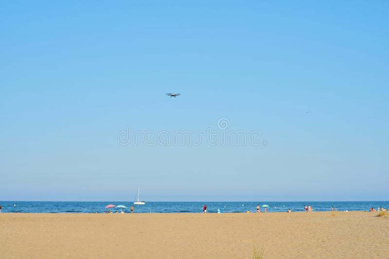 Drone flying in the beach sky in summer stock image