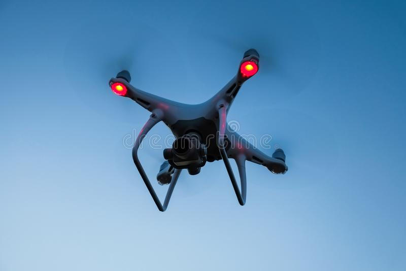 Drone is flying in the blue sky at sunset time. royalty free stock photo