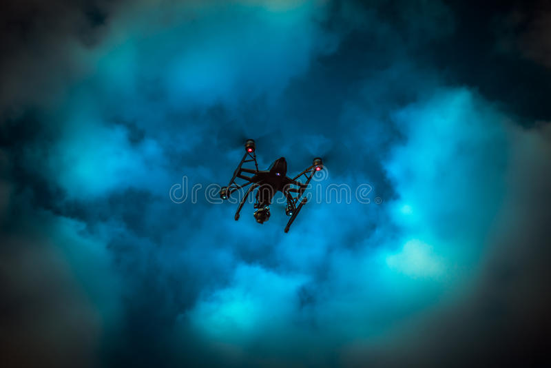Drone flying. Drone with camera flying in cloudy blue sky vector illustration