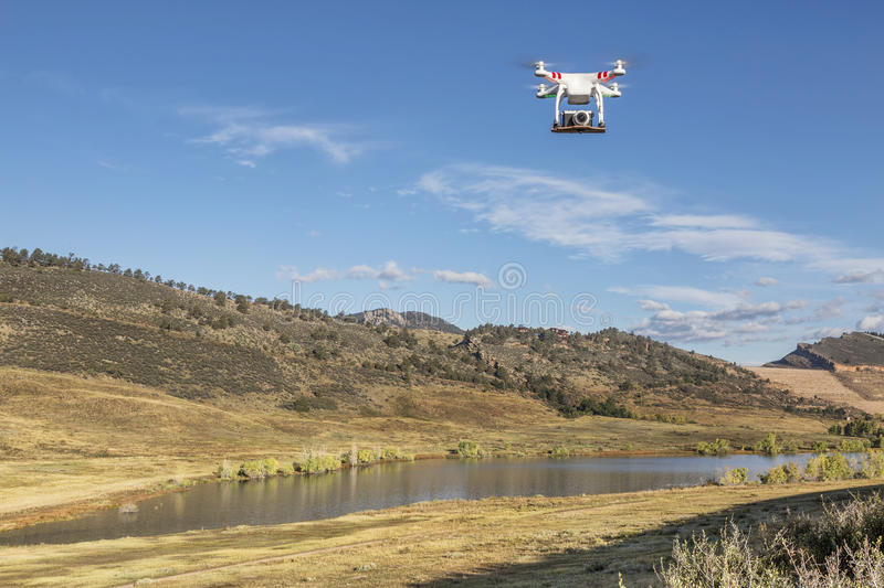 Drone flying with a camera stock photo
