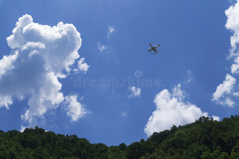 Drone flying over the blue sky. Background stock photography