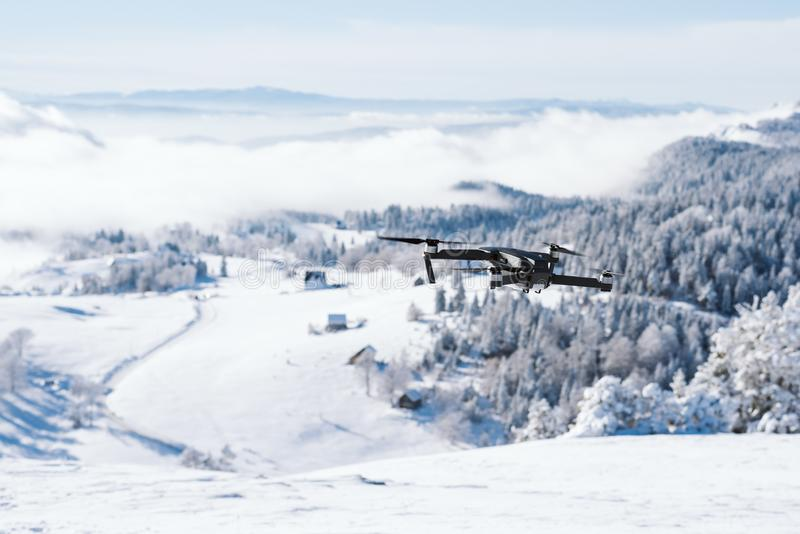 Drone flying over a mountain covered with snow royalty free stock photography