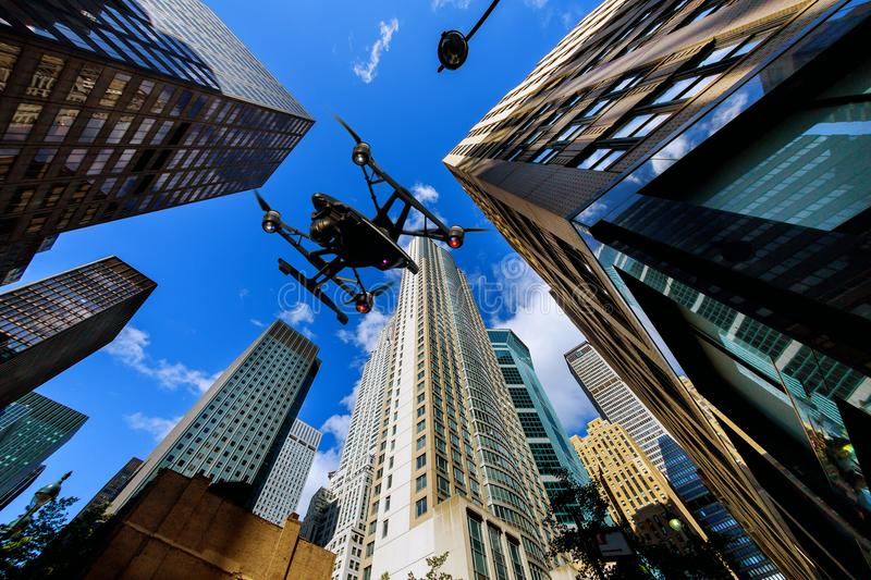 Drone flying over NEW YORK CITY Street sign of Fifth Ave and West 33rd St at sunset in New York City American on warm dramatic fil. NEW YORK CITY - June 15, 2018 royalty free stock image