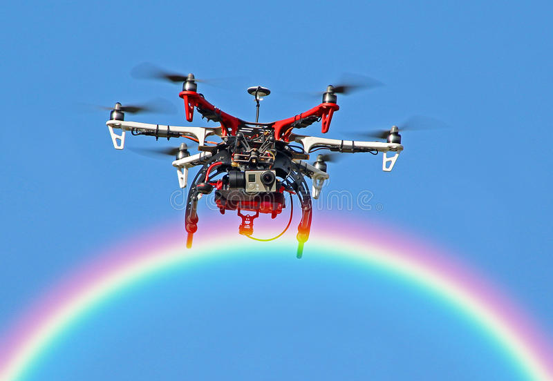 Drone flying over the rainbow stock photos