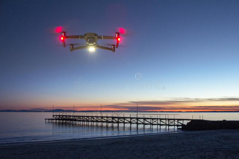 Drone flying and taking pictures of sunset stock images