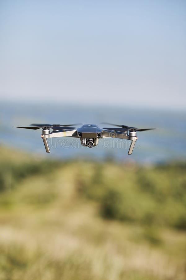 Drone hovering in the air. stock photo