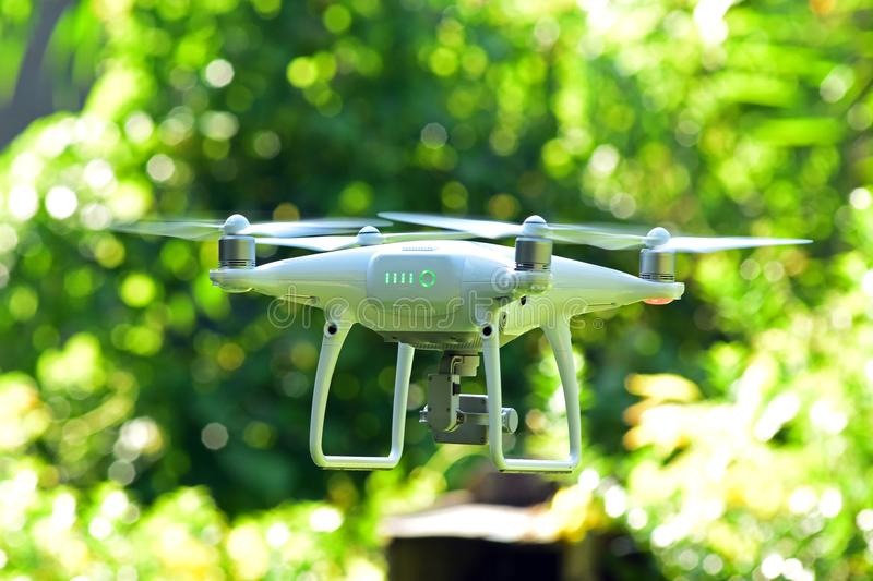 Drone hovering on green bokeh background. Drone hovering on green nature bokeh background stock photos
