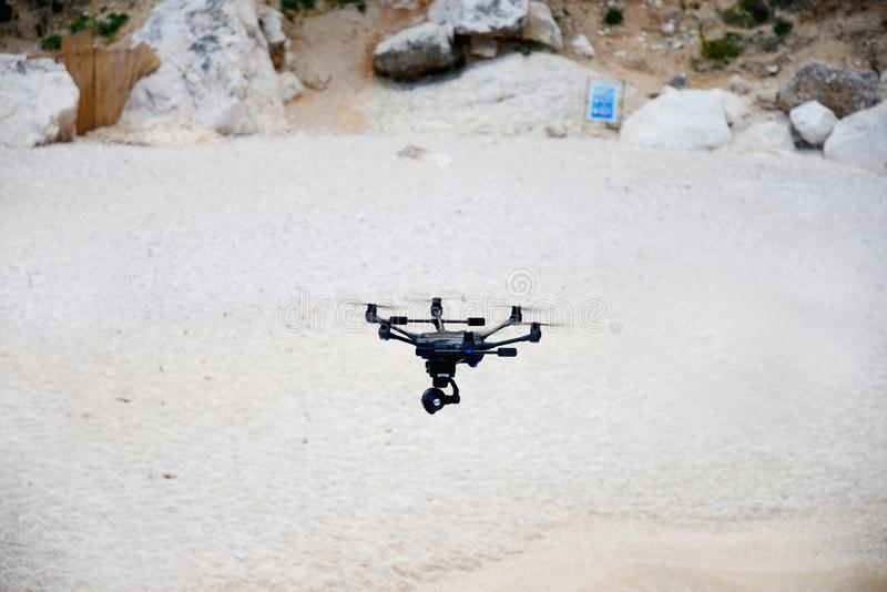 Drone hovering over beach royalty free stock images