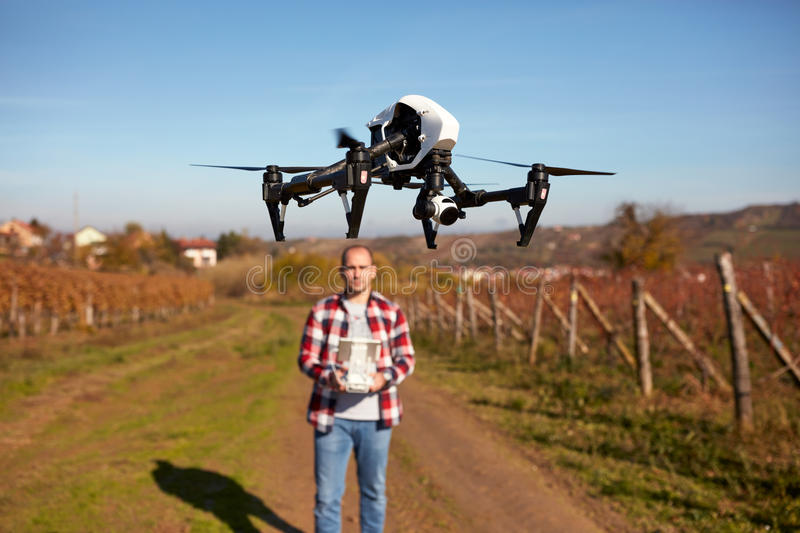 Drone hovering over ground. And filming vineyard royalty free stock photo