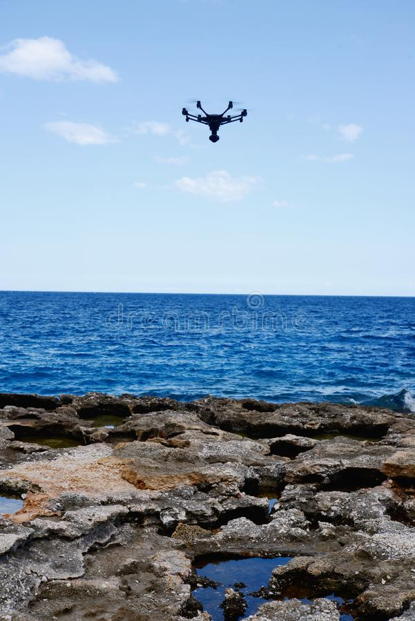 Drone hovering over sea stock image