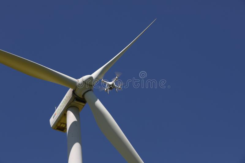 Drone hovering over wind turbines, renewable energy stock photos