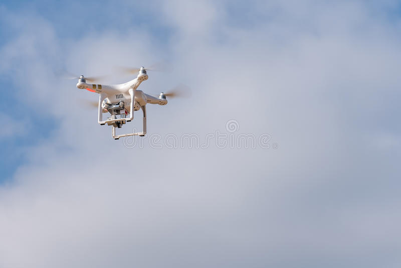 Drone hovering in the sky in the background ship industry. Phantom drone hovering over water in the background Shipbuilding Industry stock photo