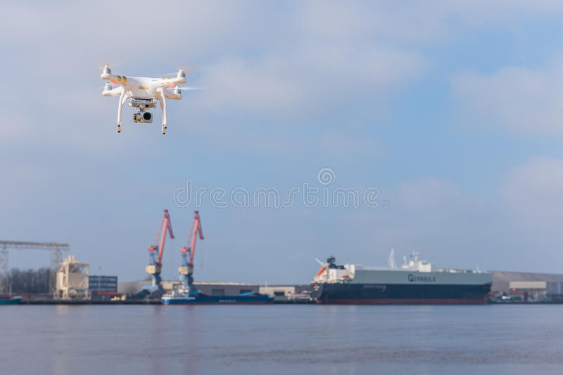 Drone hovering in the sky in the background ship industry. Phantom drone hovering over water in the background Shipbuilding Industry , Phantom 3 professional royalty free stock images