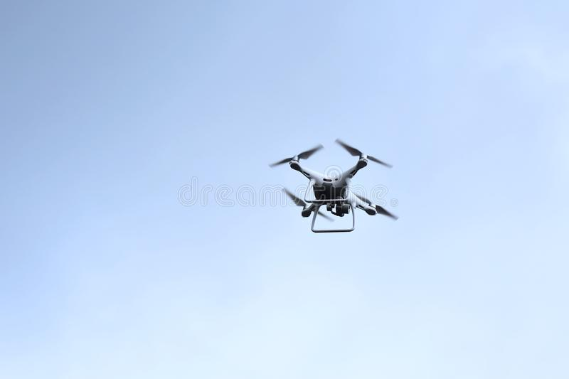 Drone hovering on sky stock photo