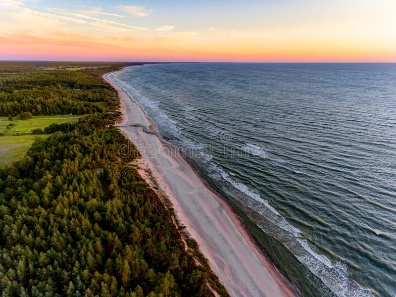 Drone image. aerial view of red sunset in the sea beach. shore line. baltic sea at dust - vintage retro look stock photo