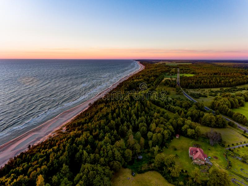 Drone image. aerial view of red sunset in the sea beach. shore line. baltic sea at dust - vintage retro look stock photos