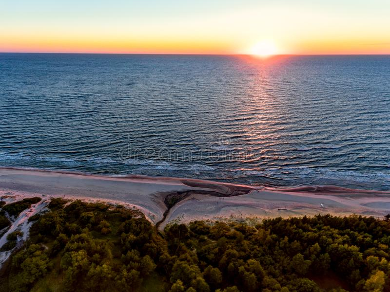 Drone image. aerial view of red sunset in the sea beach. shore line. baltic sea at dust - vintage retro look royalty free stock photos
