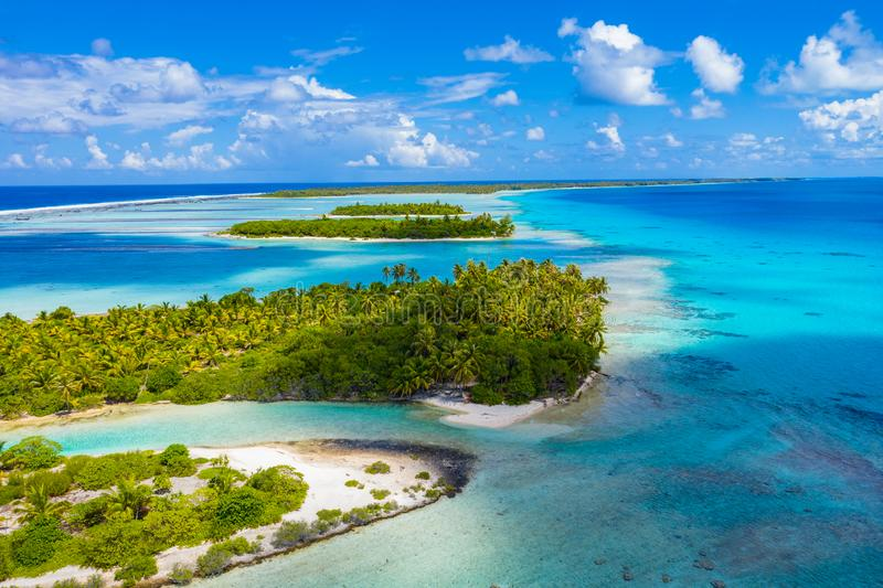 Drone image of Rangiroa atoll island reef motu in French Polynesia Tahiti. Drone aerial video of Rangiroa atoll island motu and coral reef in French Polynesia royalty free stock photo
