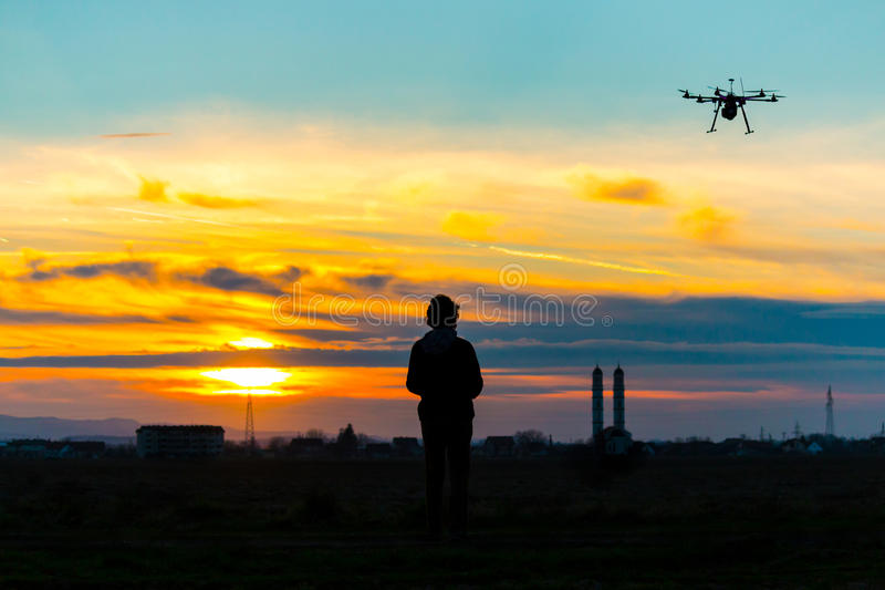 Drone over the Village at cloudy Sunset with his Pilot royalty free stock images