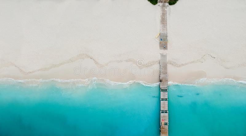 Drone panorama of pier in beach in Grace Bay, Providenciales, Tu royalty free stock images
