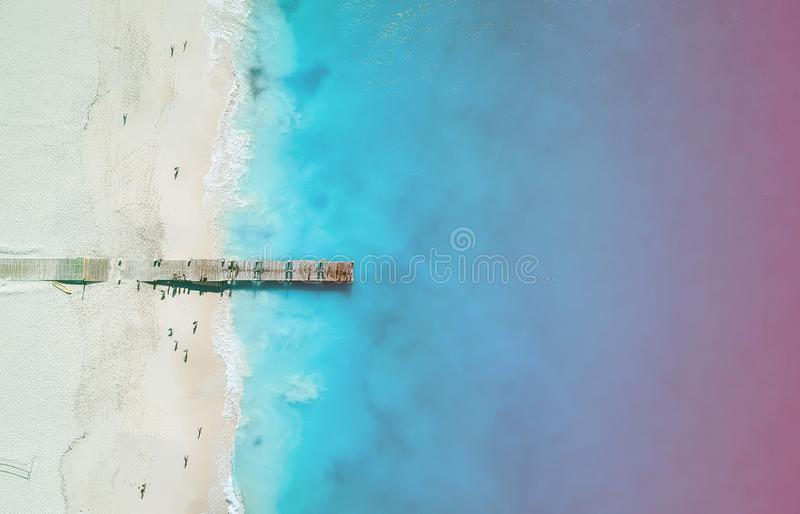 Drone panorama of pier in Grace Bay, Providenciales, Turks and Caicos with colored light leak royalty free stock photo