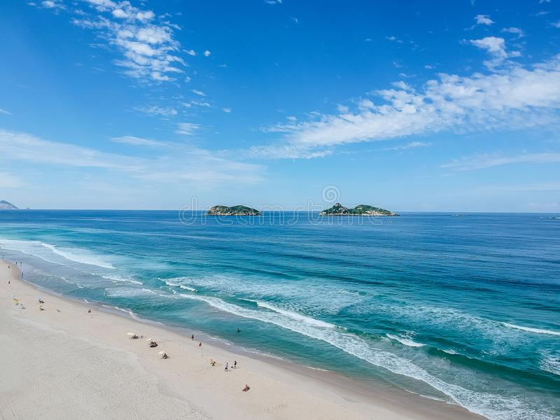 Drone photo of Barra da Tijuca beach, Tijucas Island in the back, Rio de Janeiro. Drone photo of Barra da Tijuca beach with Ilhas Tijucas and Cagarras in the stock photos