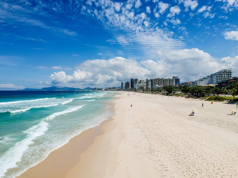Drone photo of Barra da Tijuca beach, Rio de Janeiro, Brazil. We can see the beach, some building, the boardwalk, the road and the horizon stock photography