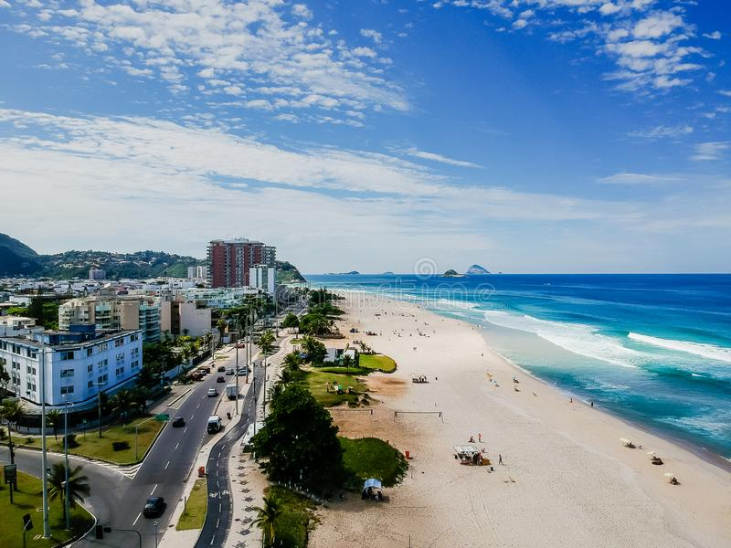 Drone photo of Barra da Tijuca beach, Rio de Janeiro, Brazil. We can see the beach, some building, the boardwalk, the road and the horizon royalty free stock photography