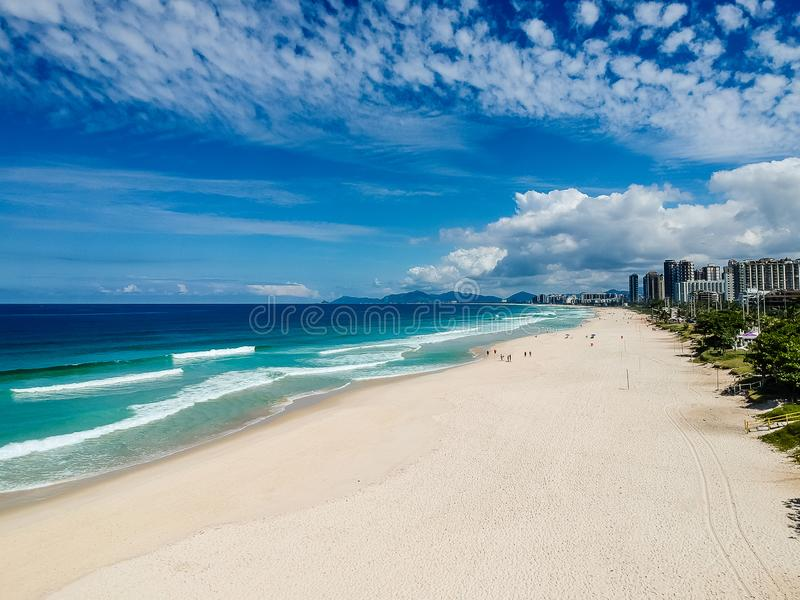 Drone photo of Barra da Tijuca beach, Rio de Janeiro, Brazil. We can see the beach, some building, the boardwalk, the road and the horizon royalty free stock photo