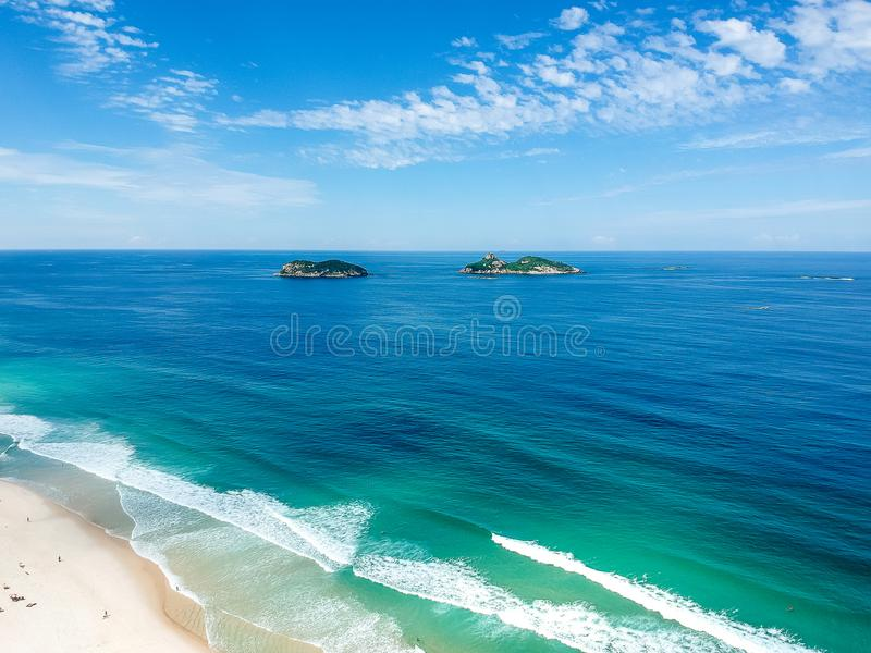 Drone photo of Barra da Tijuca beach, Tijucas Island in the back, Rio de Janeiro. Drone photo of Barra da Tijuca beach with Ilhas Tijucas and Cagarras in the royalty free stock image