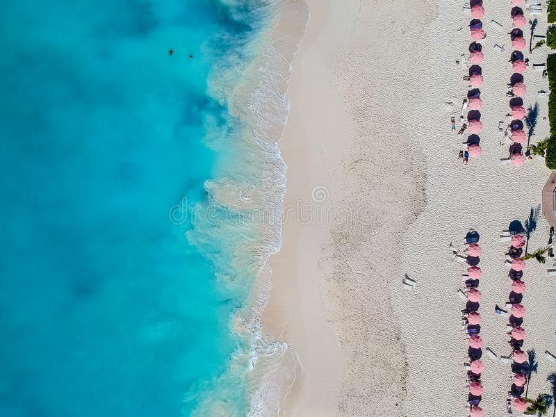 Drone photo of beach with red umbrellas in Grace Bay, Providenciales, Turks and Caicos stock image