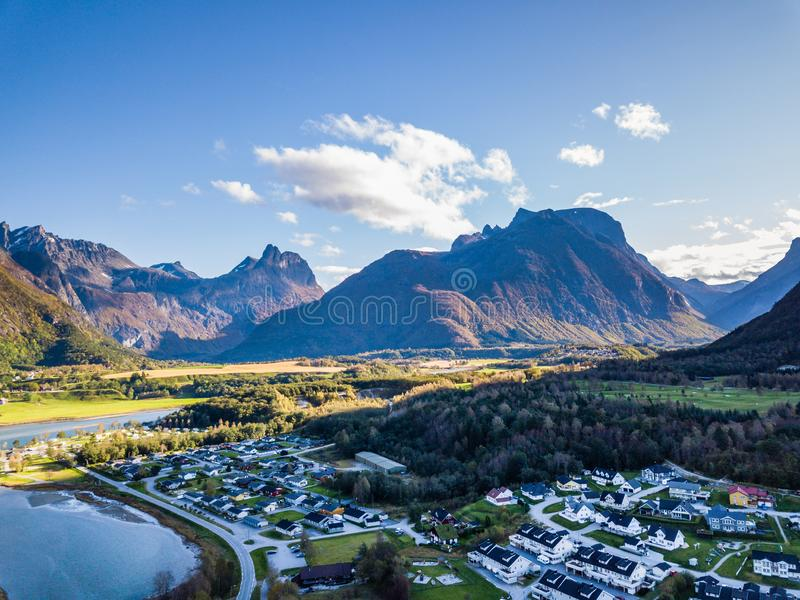 Drone Photo of the City Ã…ndalsnes in Norway on Sunny Summer Day with Mountains, Fjord and Port in the Background stock photos