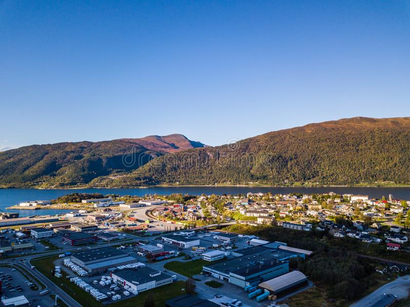 Drone Photo of the City Ã…ndalsnes in Norway on Sunny Summer Day with Mountains, Fjord and Port in the Background stock photography