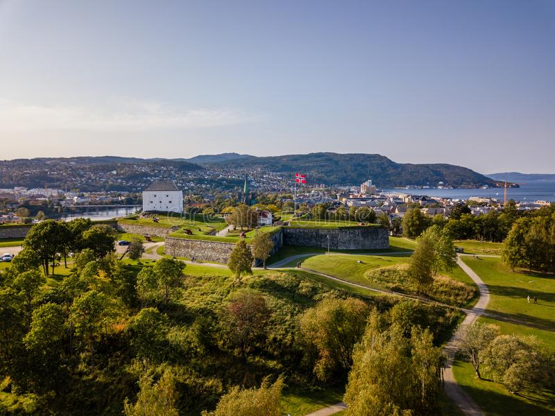 Drone Photo of the City Trondheim in Norway on Sunny Summer Day with Mountains in the Background and the Look on Old Castle royalty free stock images