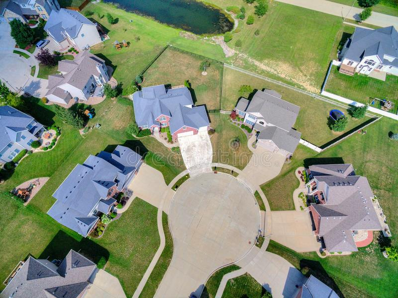 Drone photo of cul de sac. Drone real estate photo of a cul de sac and subdivision with a pond royalty free stock photo