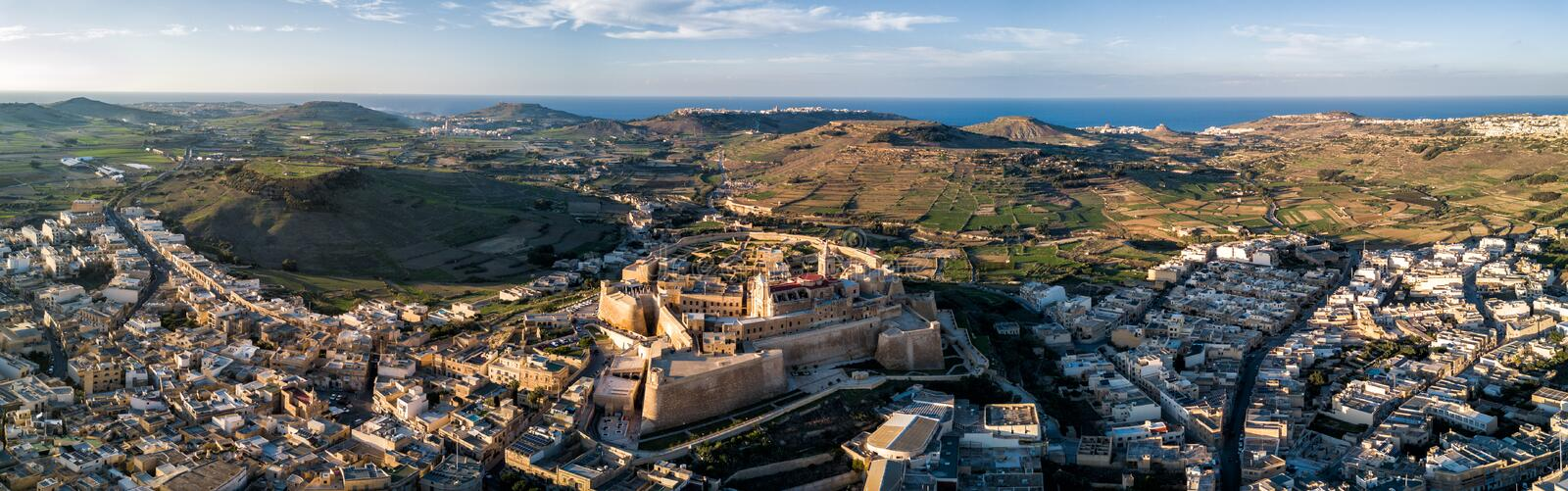 Drone photo - The Gozo Citadel at sunset. Malta. Aerial drone photo - The Gozo Citadel at sunset. A medieval fortress in the city of Victoria Rabat. Island of royalty free stock images
