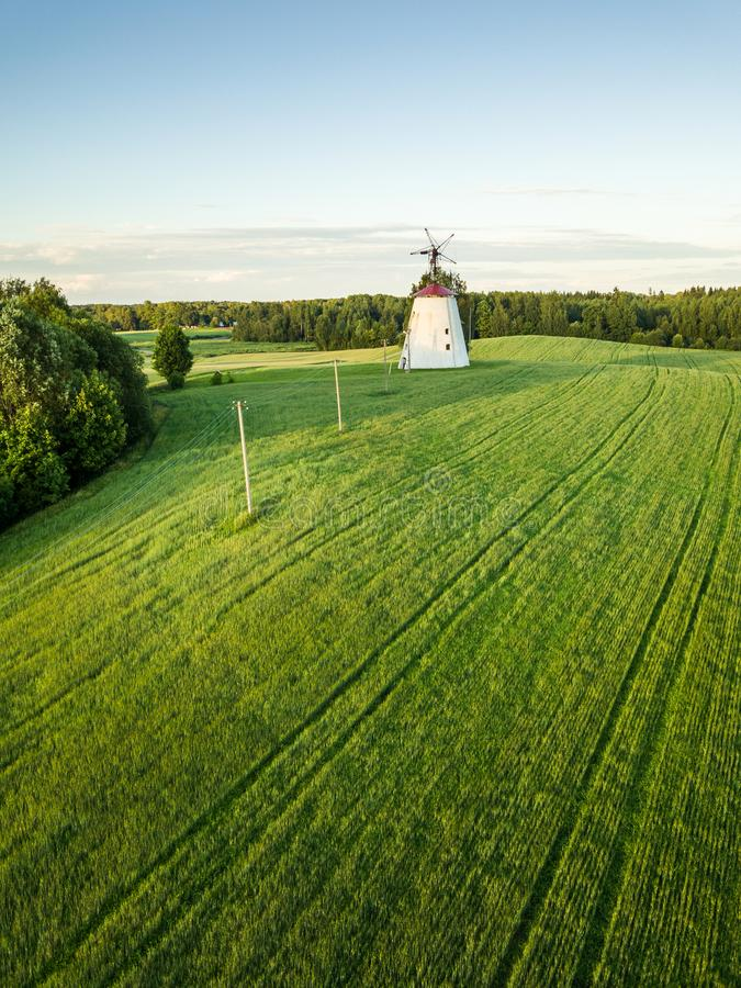 Drone Photo of the Green Wheat Field Next to Old Windmill stock photography