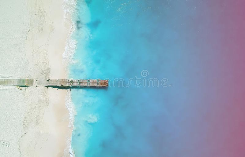 Drone panorama of pier in Grace Bay, Providenciales, Turks and Caicos with light leak stock image