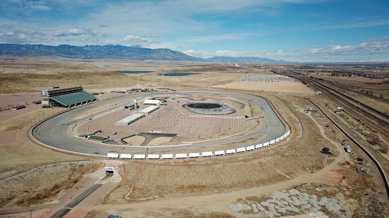 Race track in the Colorado desert. Drone photo of Pikes Peak International Raceway near Colorado Springs, Colorado. Solar farm, Volkswagen recall parking lot royalty free stock photo