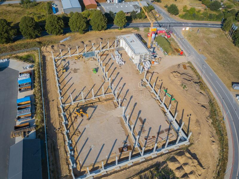 Drone photograph of a construction site with concrete supports for a factory building royalty free stock image