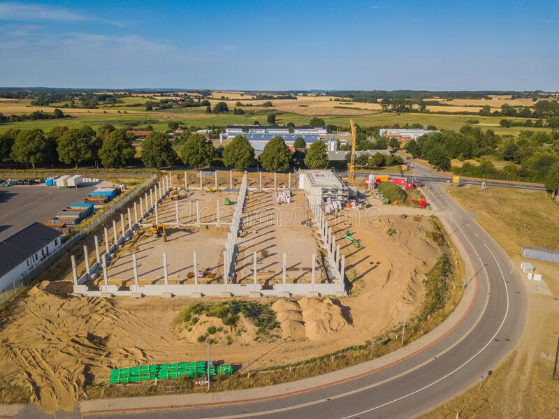 drone photograph of a construction site with concrete supports for a factory building royalty free stock images
