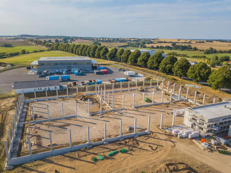 Drone photograph of a construction site with concrete supports for a factory building royalty free stock photo