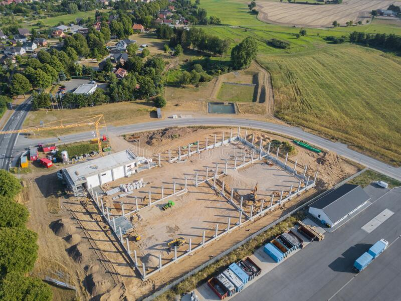 Drone photograph of a construction site with concrete supports for a factory building. A drone photograph of a construction site with concrete supports for a royalty free stock photography