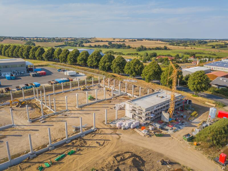 drone photograph of a construction site with concrete supports for a factory building stock image