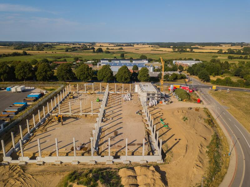 Drone photograph of a construction site with concrete supports for a factory building. A drone photograph of a construction site with concrete supports for a royalty free stock image