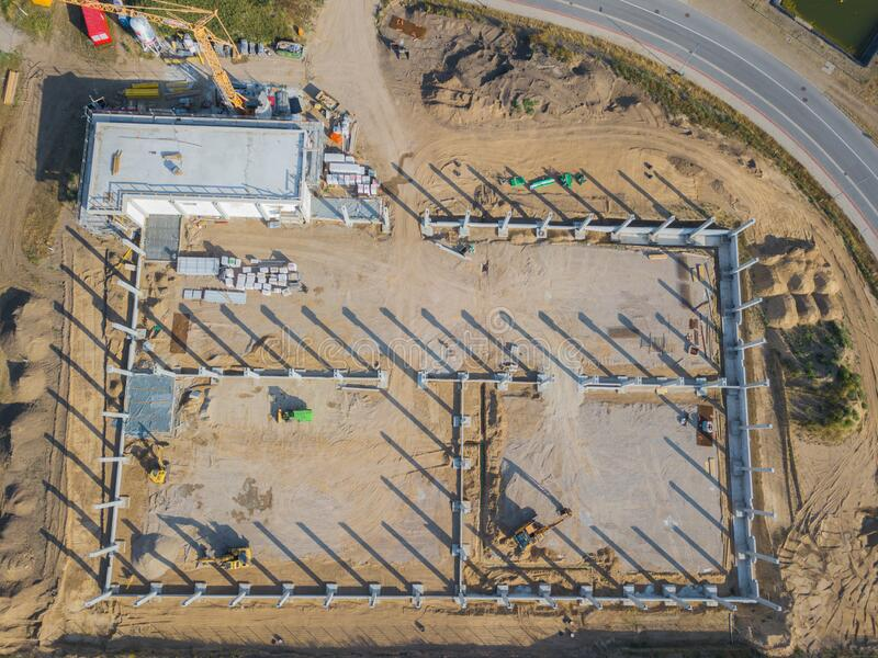 Drone photograph of a construction site with concrete supports for a factory building. A drone photograph of a construction site with concrete supports for a stock images
