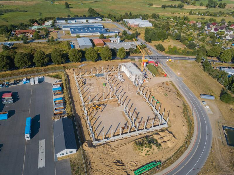 Drone photograph of a construction site with concrete supports for a factory building. A drone photograph of a construction site with concrete supports for a stock image